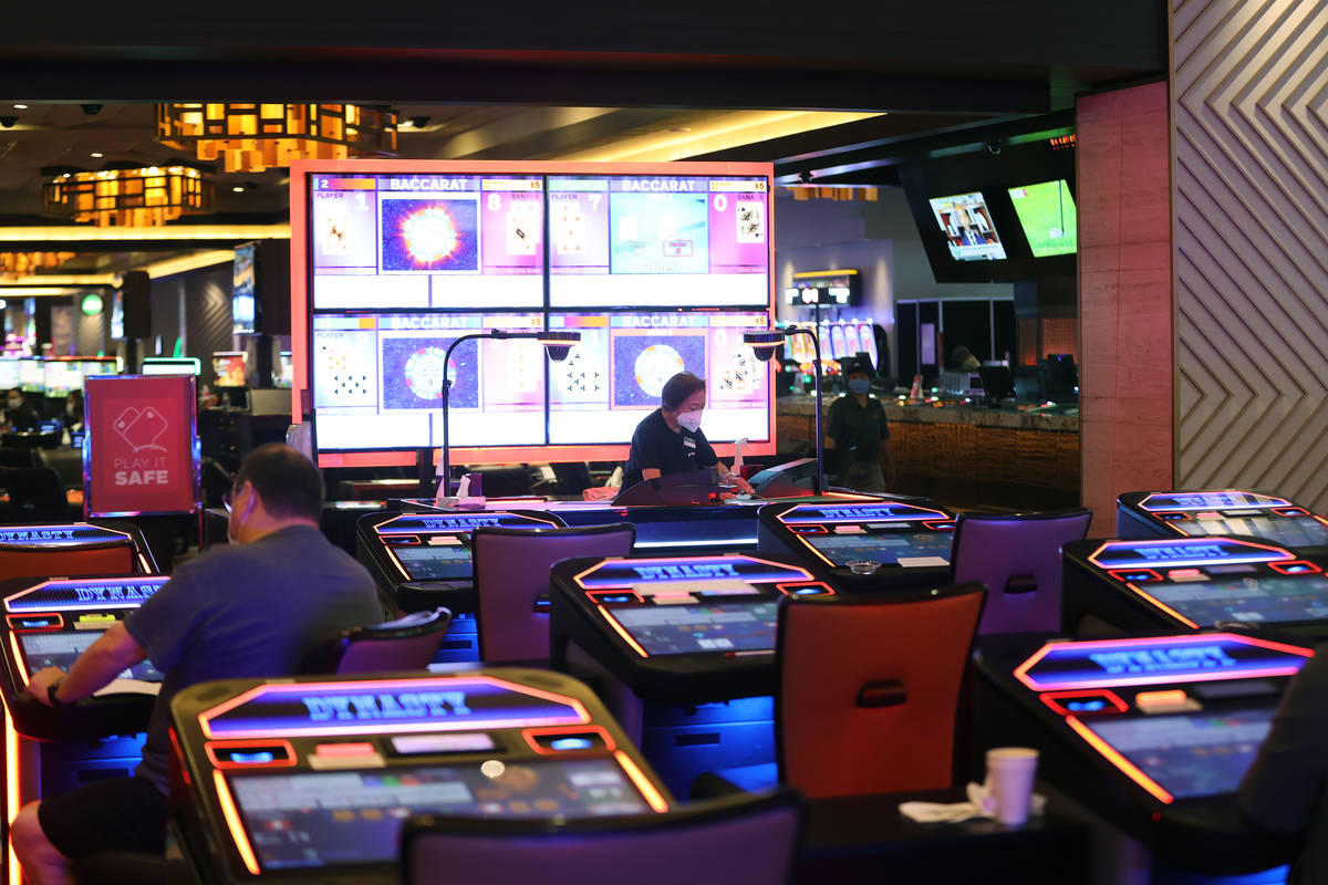 Table game dealer Annie Sit deals cards during a game of baccarat at Palace Station Casino in L ...
