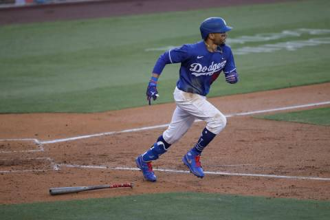Los Angeles Dodgers' Mookie Betts lines out to center field during the fourth inning of an exhi ...