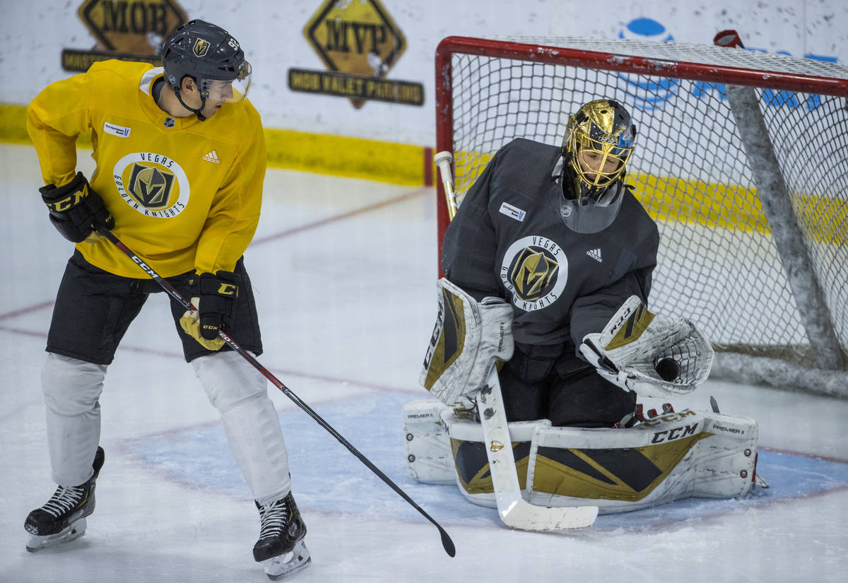Vegas Golden Knights left wing Tomas Nosek (92, left) has a deflection on goal stopped by goalt ...