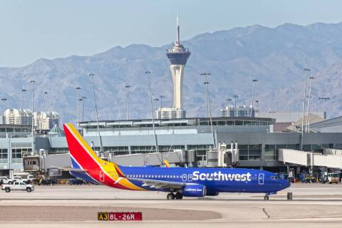 A Southwest plane taxis to its gate at McCarran International Airport on Tuesday, March 31, 202 ...
