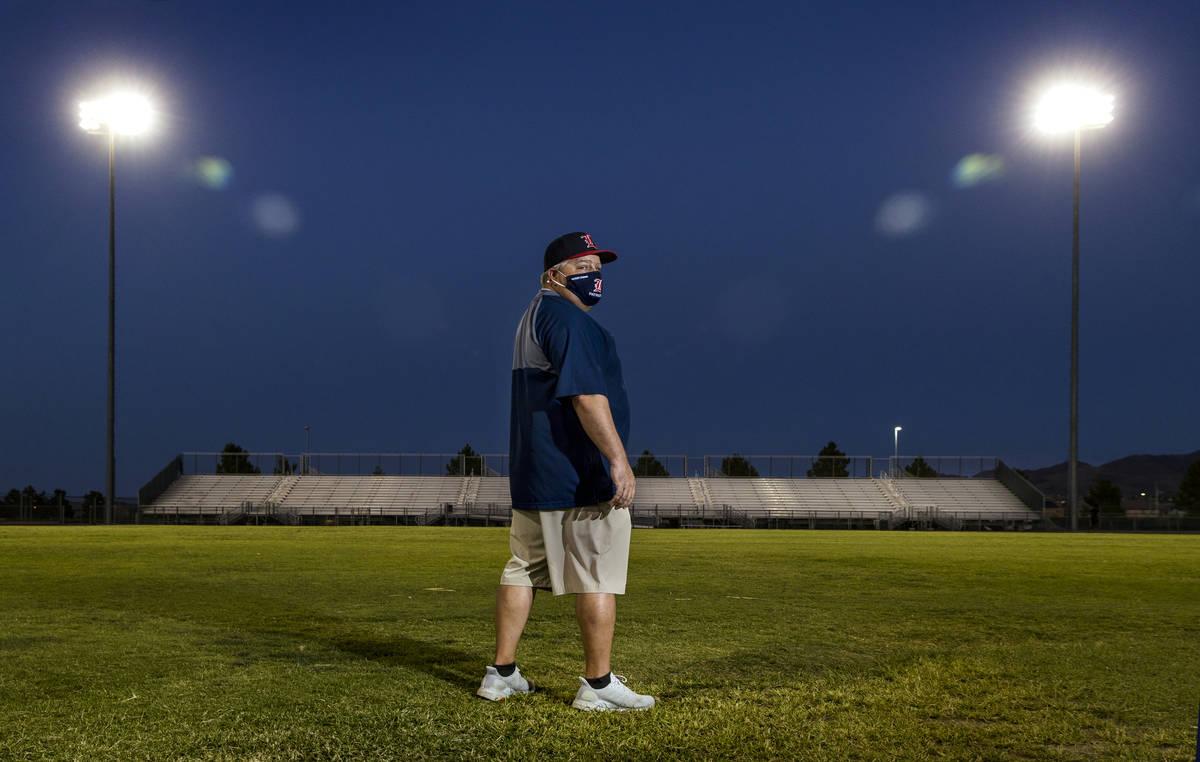 Liberty High School football coach Rich Muraco stands on the empty football field on Thursday, ...