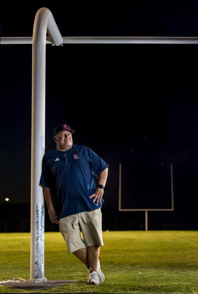 Liberty High School football coach Rich Muraco at the goalpost on the empty football field on T ...