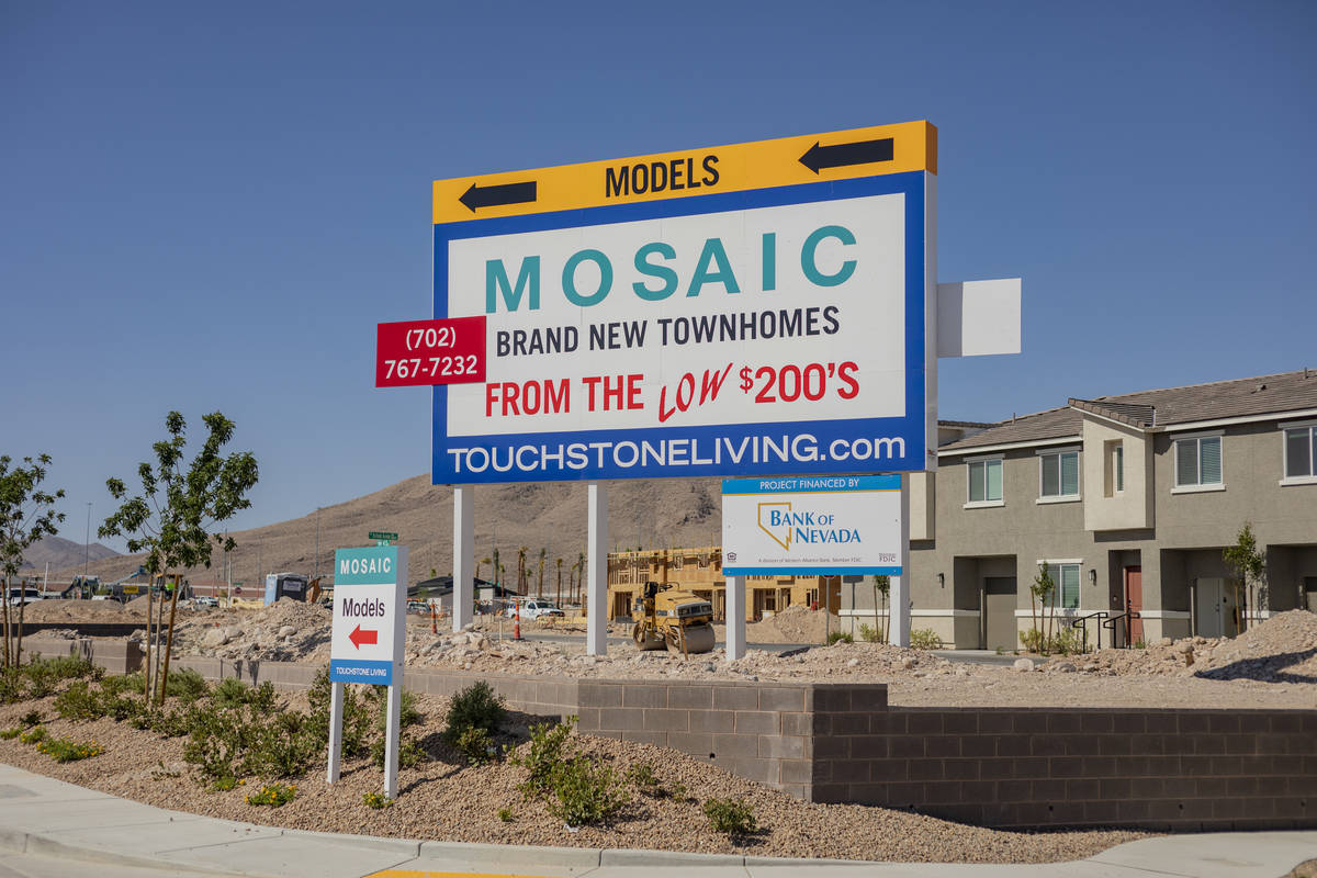 A sign advertising models of the Mosaic townhome community is seen, located south of the Las Ve ...