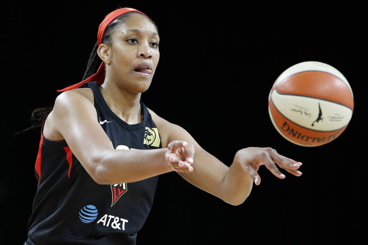 Las Vegas Aces' A'ja Wilson passes against the Washington Mystics during the first half of Game ...