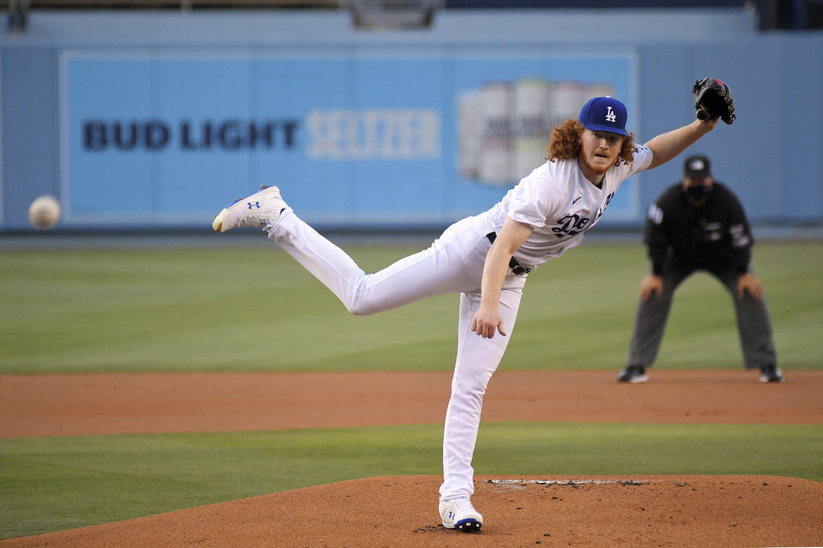 Los Angeles Dodgers starting pitcher Dustin May throws to the plate during the first inning of ...