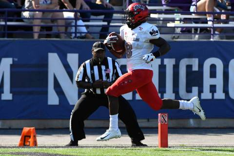 UNLV running back Charles Williams (8) runs for a touchdown against Northwestern during the fir ...