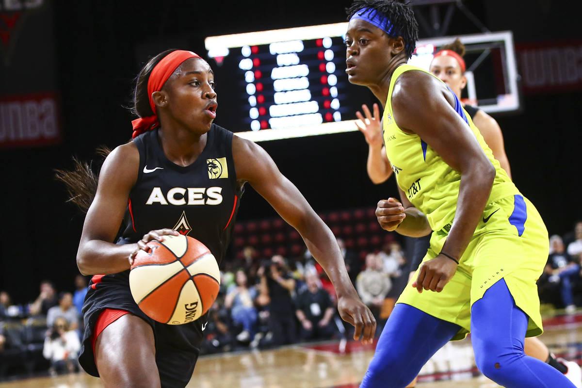 Las Vegas Aces' Jackie Young (0) drives to the basket against Dallas Wings' Kaela Davis (3) dur ...