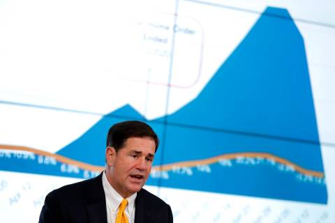 Arizona Republican Gov. Doug Ducey gives the latest Arizona coronavirus update during a news co ...