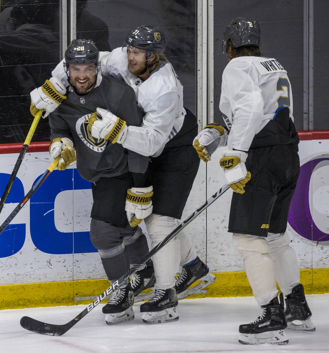 Vegas Golden Knights left wing William Carrier (28, left) is wrapped up by center William Karls ...
