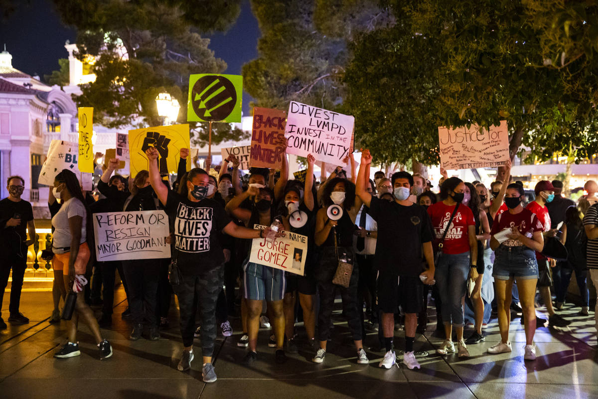 People participate during a Black Lives Matter rally on the Las Vegas Strip on Saturday, July 2 ...