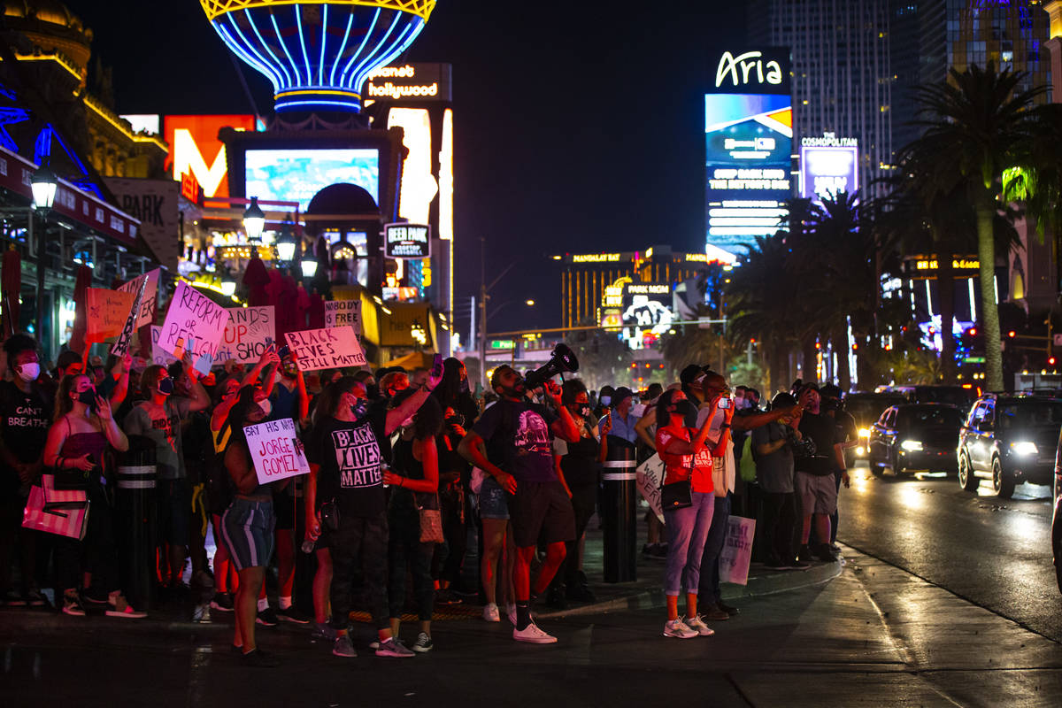 People record and chant after Las Vegas police stopped a car that was assisting Black Lives Mat ...