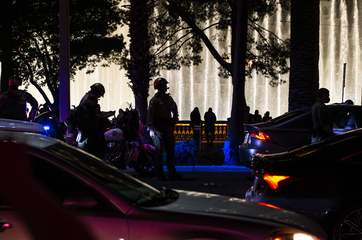 Las Vegas police stop a car that was assisting Black Lives Matter protesters near the Bellagio ...