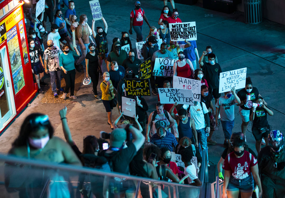 People march during a Black Lives Matter rally on the Las Vegas Strip on Saturday, July 25, 202 ...