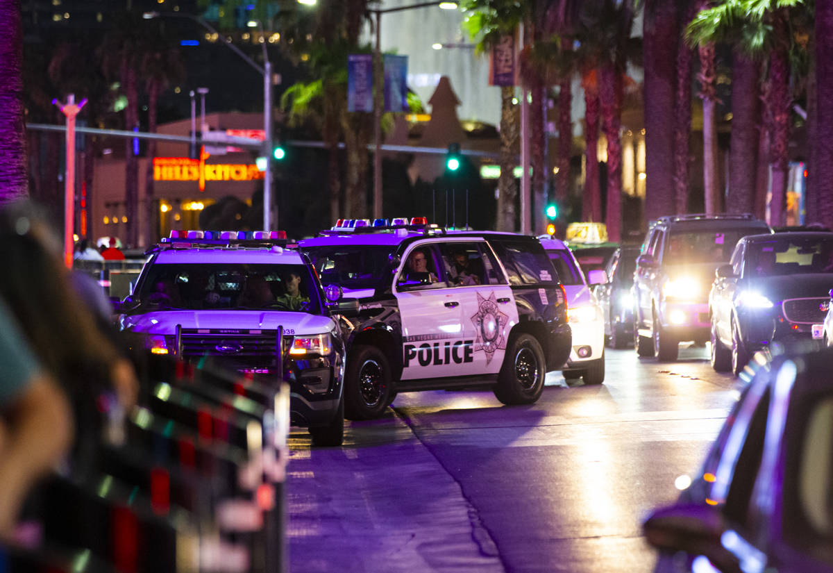 Las Vegas police watch people march during a Black Lives Matter rally on the Las Vegas Strip on ...