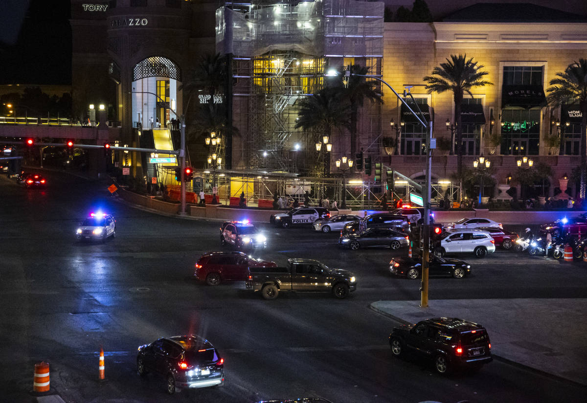 Las Vegas police gather nearby during a Black Lives Matter rally on the Las Vegas Strip on Satu ...