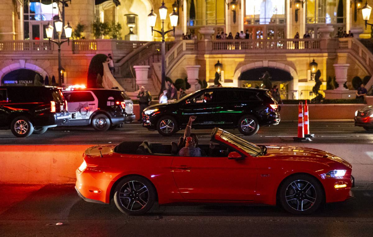 People in a car cheer during a Black Lives Matter rally on the Las Vegas Strip on Saturday, Jul ...
