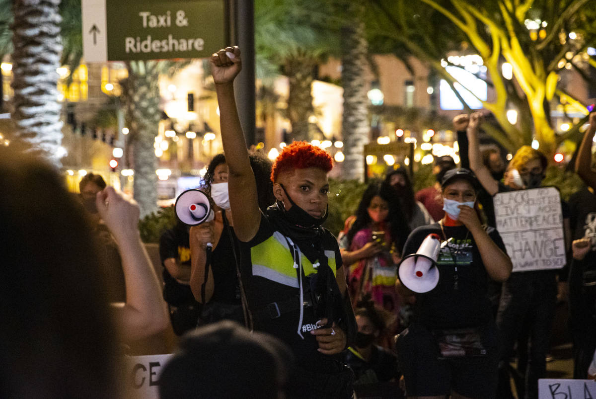 Zyera Dorsey raises her fist during a Black Lives Matter march on the Las Vegas Strip on Saturd ...