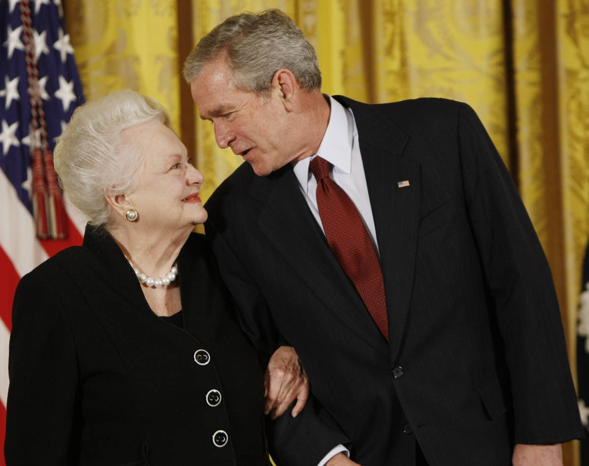 President George W. Bush greets actress Olivia de Havilland as he presented her with the 2008 N ...
