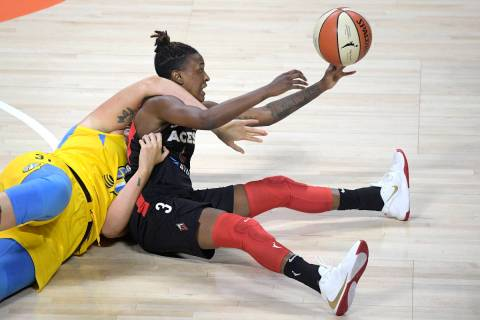 Las Vegas Aces guard Danielle Robinson (3) passes after gaining control of the ball in front of ...
