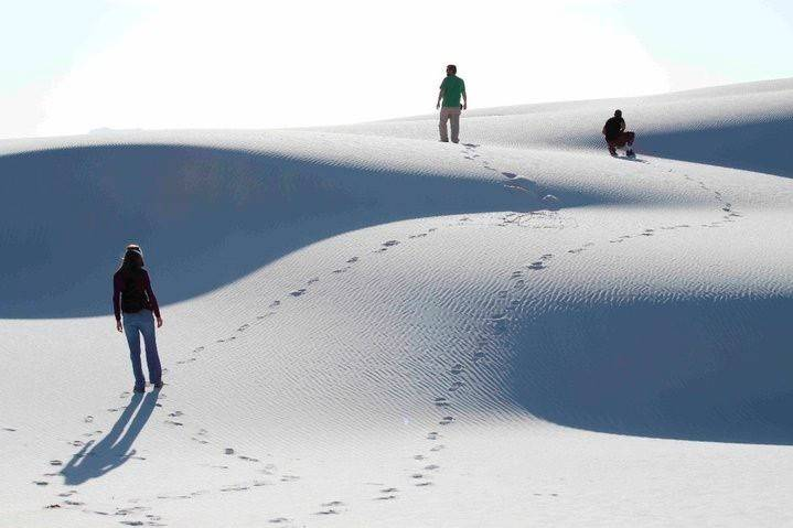 Visitors hike the shifting dunes of White Sands National Monument near Alamogordo, N.M., in 201 ...