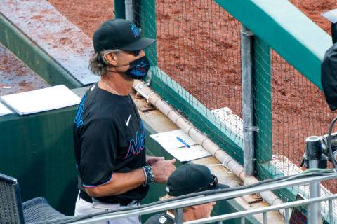 Miami Marlins' manager Don Mattingly looks out from the dugout during the eighth inning of a ba ...