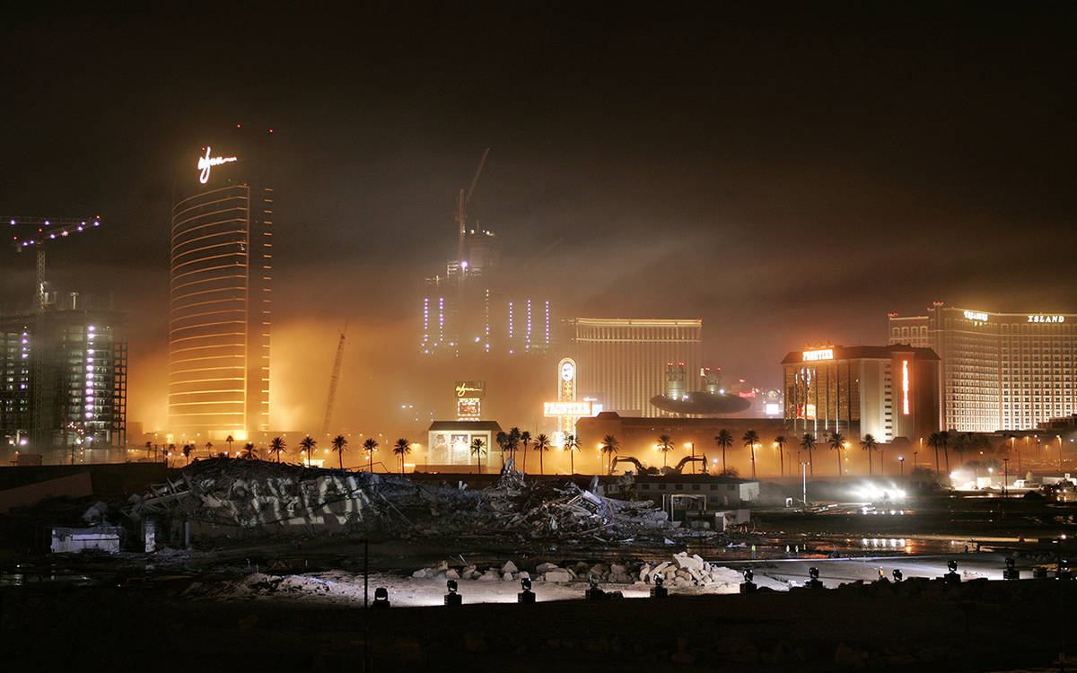 Dust hangs in the air after the Stardust hotel-casino was imploded early Tuesday morning, March ...
