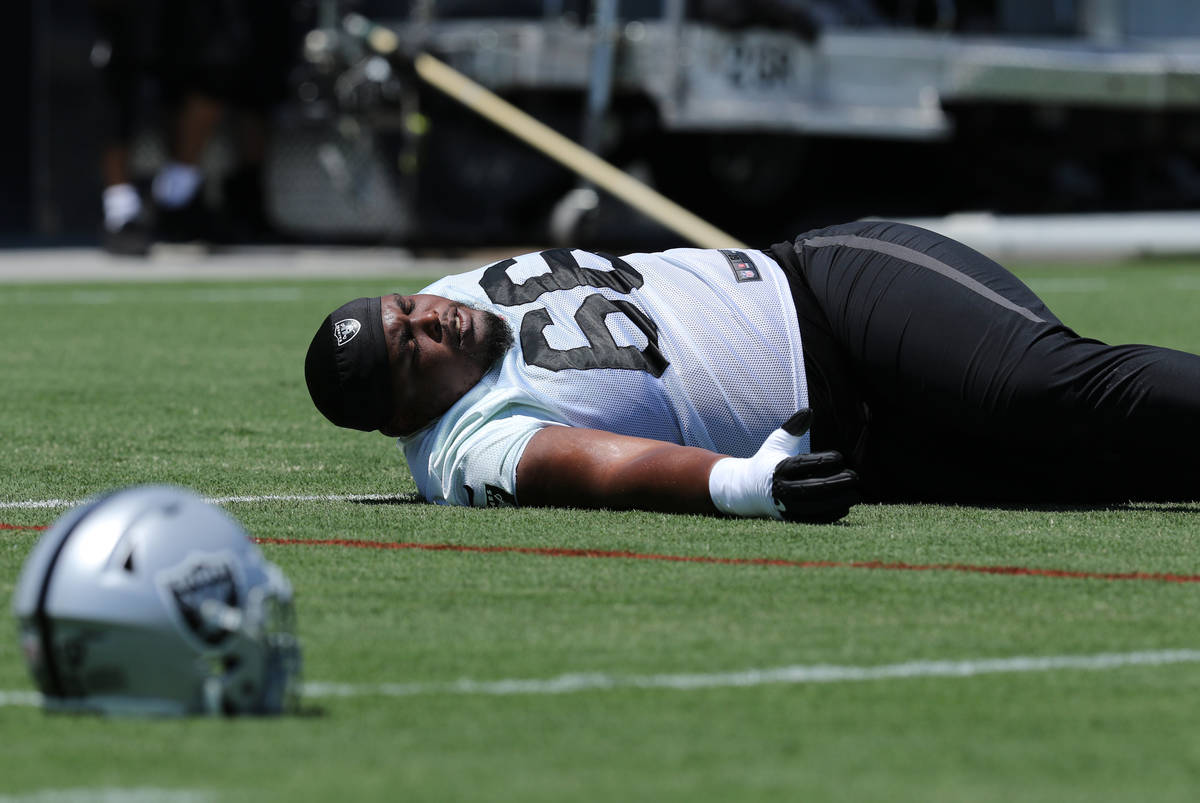 Oakland Raiders offensive guard Gabe Jackson (66) stretches during a mandatory mini-camp workou ...