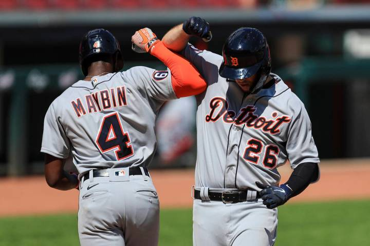 Detroit Tigers' C.J. Cron (26) celebrates with Cameron Maybin (4) after hitting a two-run home ...