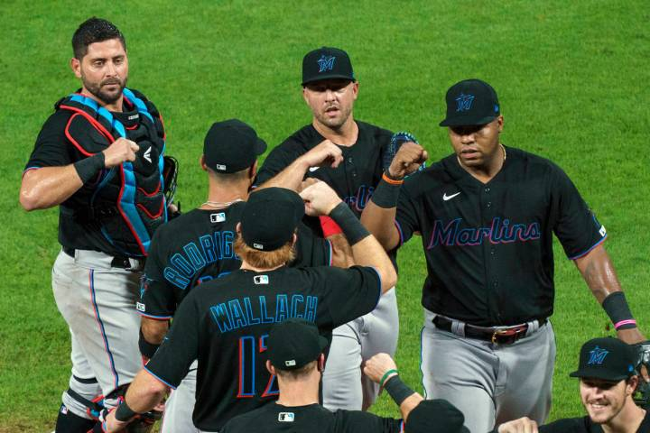 In this Friday, July 24, 2020, file photo, Miami Marlins' Jesus Aguilar, right, celebrates a 5- ...