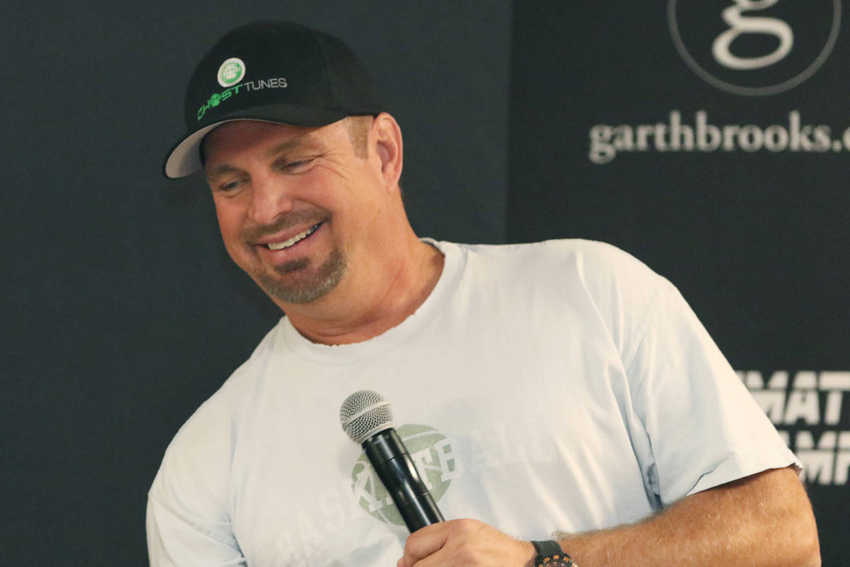 Country music star Garth Brooks answers questions about his world tour during a news conference ...