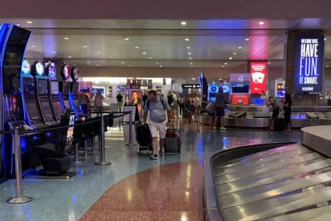 Travelers arrive in Las Vegas at McCarran International Airport on Friday June, 5, 2020. (Mick ...