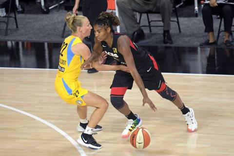 Las Vegas Aces guard Angel McCoughtry, right, drives to the lane in front of Chicago Sky guard ...