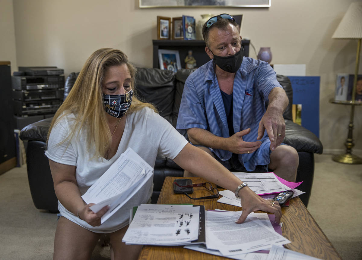 Tracy and David Lamonica look through some of her mothers paperwork, 80-year-old Phyllis Wyant, ...
