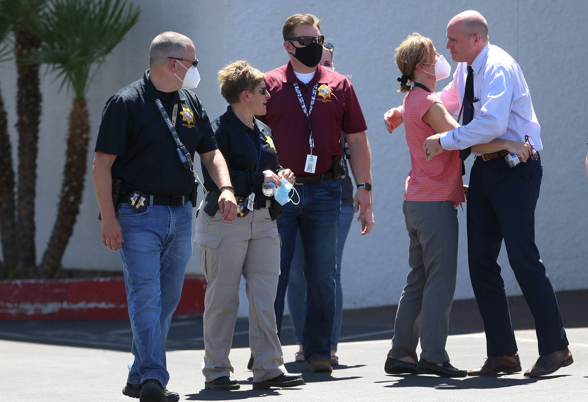 People including members of the Las Vegas Metropolitan Police Department outside of the Palm Do ...