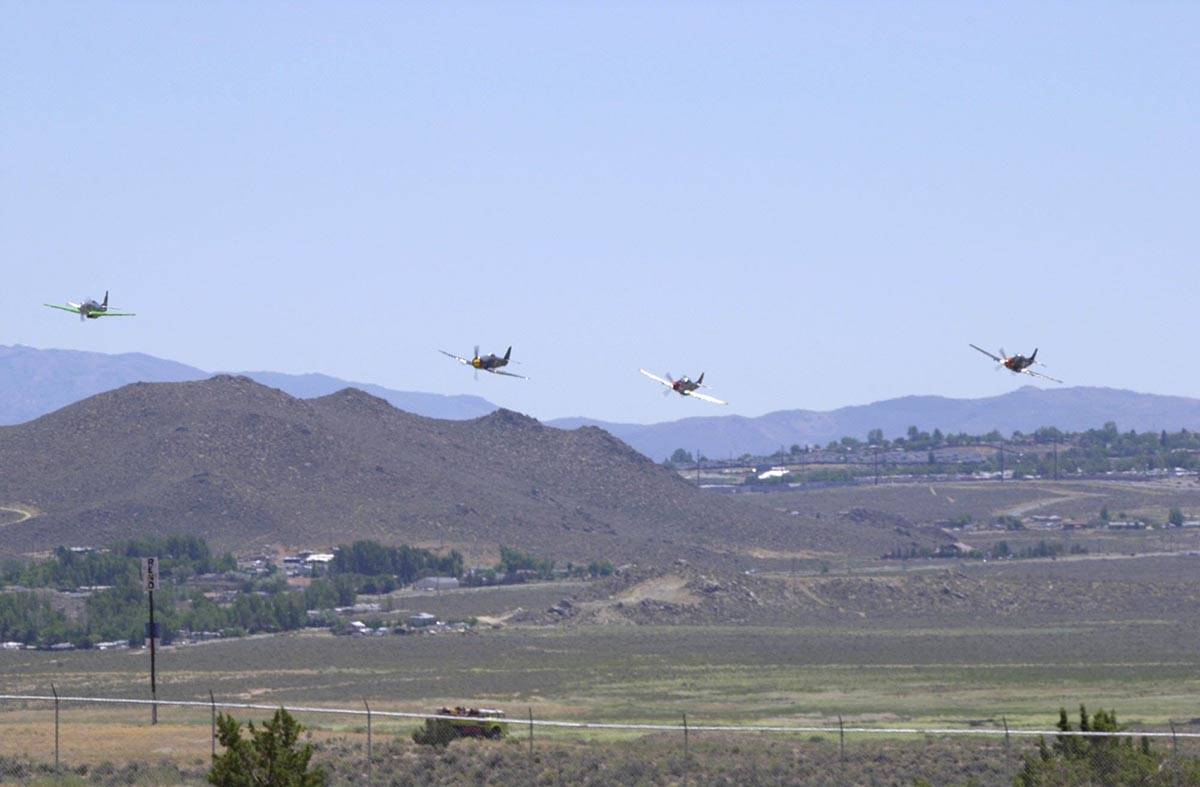 This shot shot taken at the 2002Pylon Racing School at Reno-Stead Airport. From left to right: ...