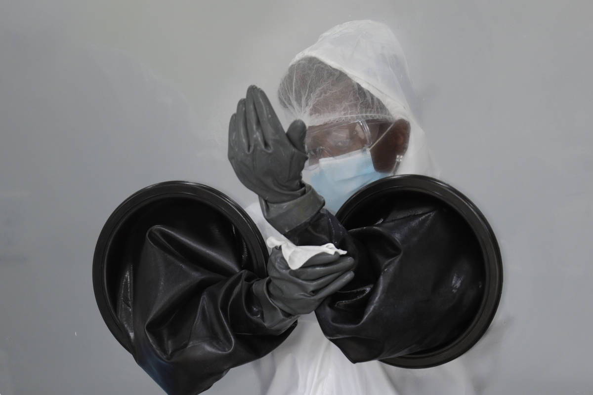 FILE - In this July 17, 2020, file photo, a health care worker sanitizes her equipment while wo ...