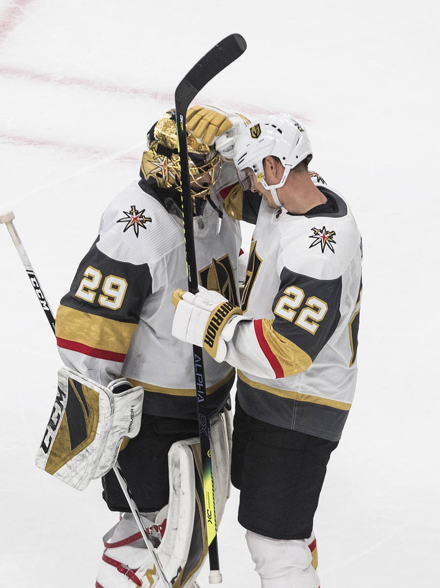Vegas Golden Knights goalie Marc-Andre Fleury (29) and teammate Nick Holden celebrate a win ove ...