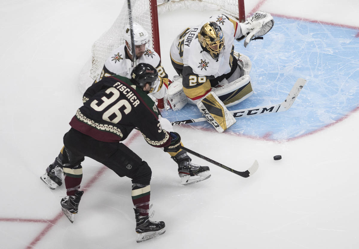 Arizona Coyotes' Christian Fischer (36) is stopped by Vegas Golden Knights goalie Marc-Andre Fl ...
