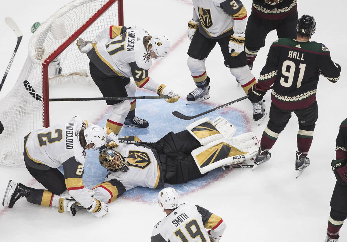 Vegas Golden Knights goalie Marc-Andre Fleury (29) gives up a goal to Arizona Coyotes Taylor Ha ...