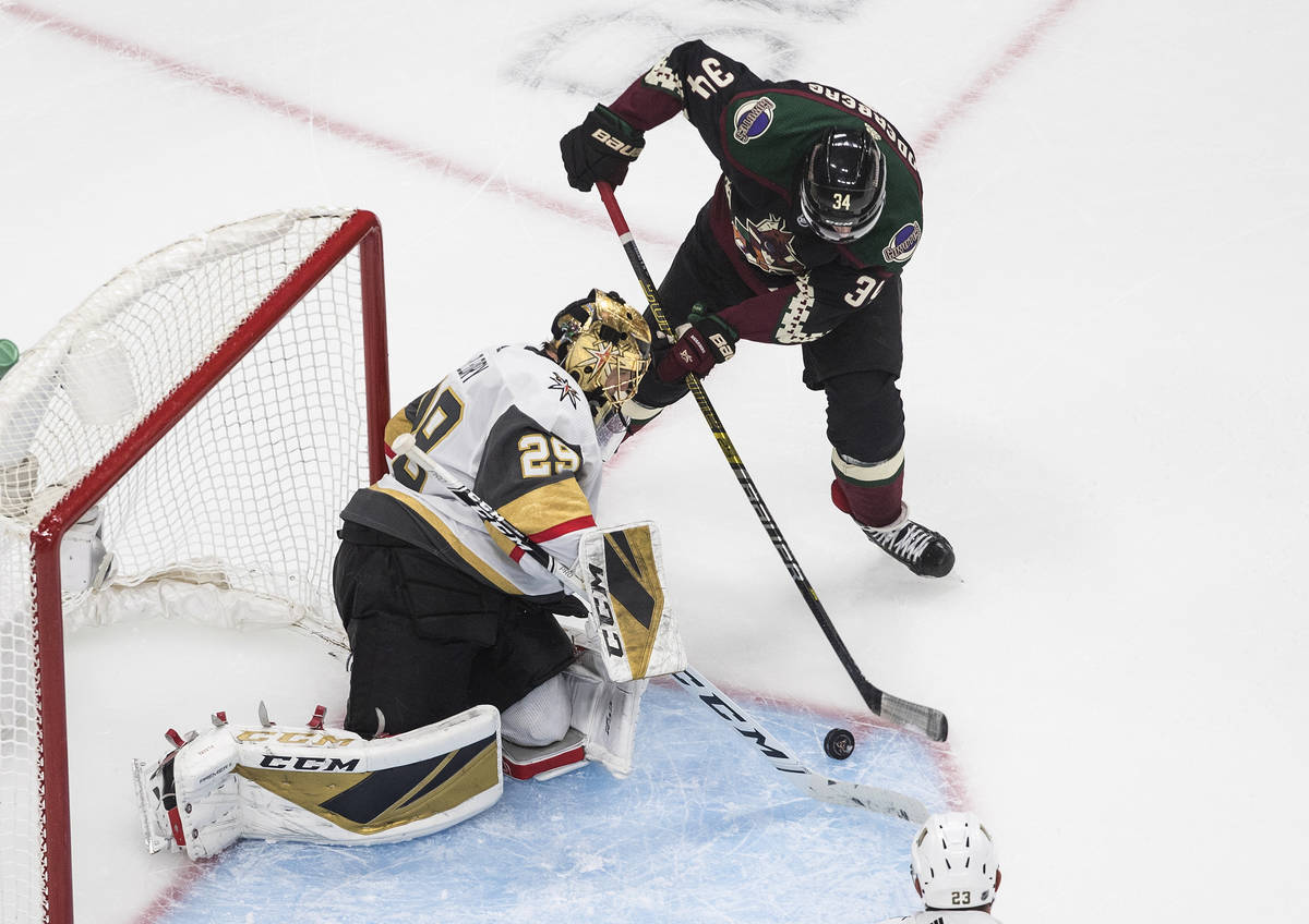 Arizona Coyotes' Carl Soderberg (34) is stopped by Vegas Golden Knights goalie Marc-Andre Fleur ...