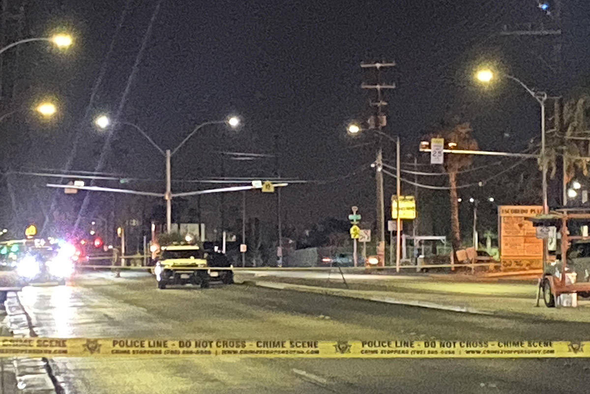 Police detectives investigate a double homicide in the 700 block of North Eastern Avenue near M ...