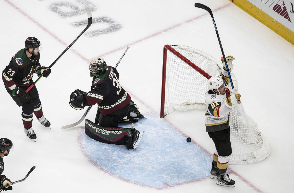 Arizona Coyotes goalie Darcy Kuemper (35) is scored on as Vegas Golden Knights' Nick Cousins (2 ...