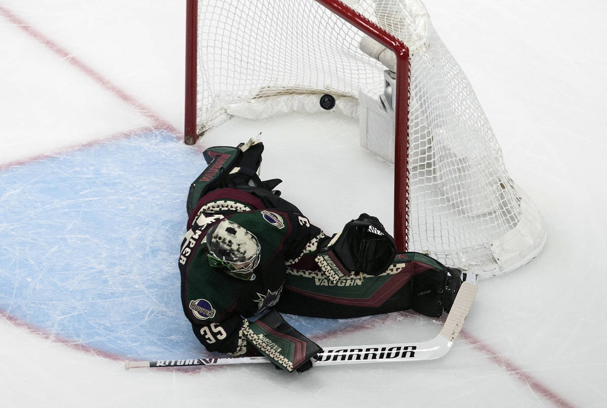 Arizona Coyotes' goalie Darcy Kuemper (35) is scored on by the Vegas Golden Knights during the ...