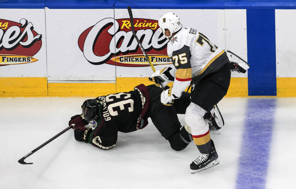 Arizona Coyotes' Alex Goligoski (33) is checked by Vegas Golden Knights' Ryan Reaves (75) durin ...