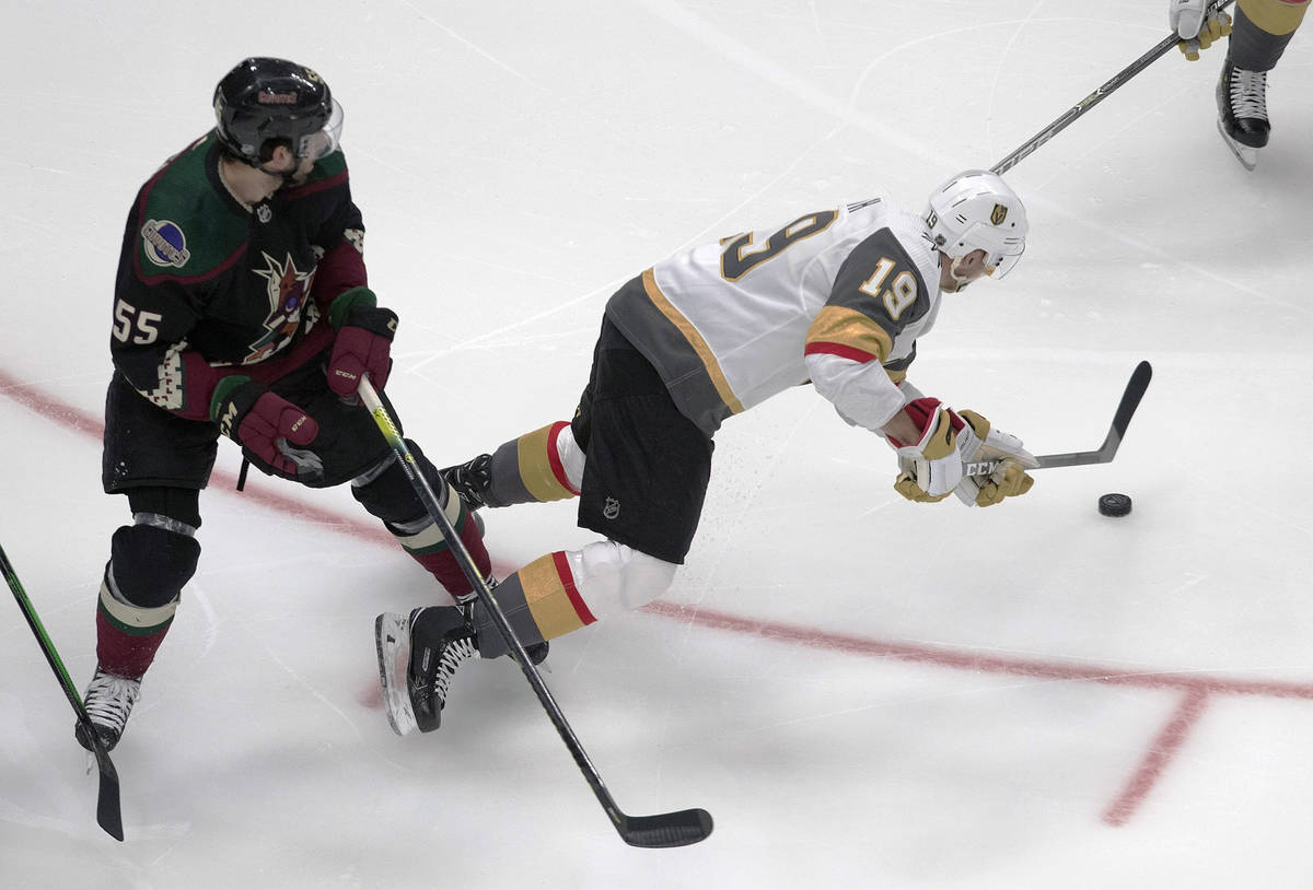Arizona Coyotes' Jason Demers (55) trips up Vegas Golden Knights' Reilly Smith (19) during the ...
