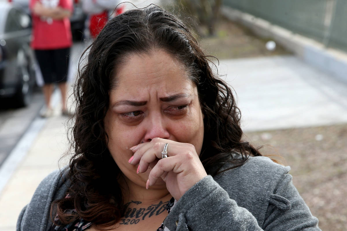 Alpine Motel Apartments co-owner Malinda Mier cries while telling the story of her maintenance ...
