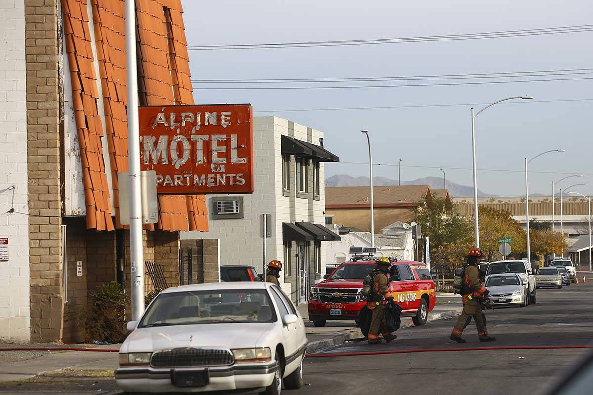 Las Vegas firefighters work a fire at the Alpine Motel Apartments, Dec. 21, 2019 in Las Vegas. ...