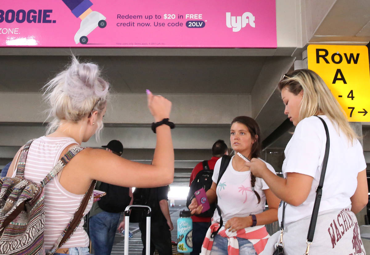 Erika Roxin, left, Izzy Navaro and Jaime Finnigan wait for their driver at ride-hailing compan ...