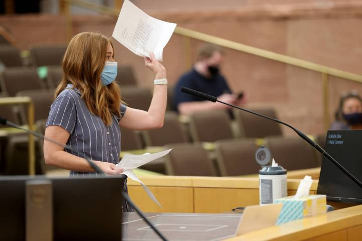 Kristen Corral, owner of Tacotarian restaurant, holds up letters from fellow restaurant owners ...
