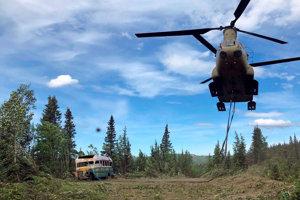 Alaska Army National Guard soldiers use a CH-47 Chinook helicopter to remove an abandoned bus, ...